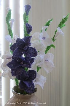 This pattern I call Floral Ensemble is a combination pattern for my gladiolus crochet decor and cattail accent.
