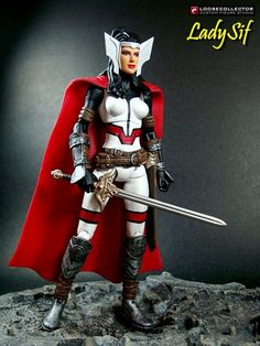 this is a marvel legends Lady Sif Custom Action Figure she was made by figure realmer loosecollector he use a Elektra body, hope lower legs and wrist guards, and dc universe classics superman cape happy pinning