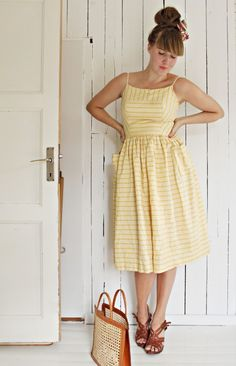 Yellow dress with stripes and pockets? Love.