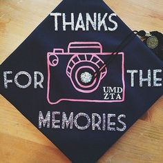 Painted Camera Graduation Cap. Stay in trend with this graduation cap painted with silver glittering wording as well as pink camera design. http://hative.com/graduation-cap-ideas/