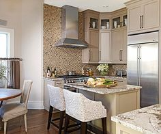 Attention to detail makes this quaint kitchen a standout! Find more looks here: http://www.bhg.com/decorating/decorating-photos/kitchen/neutral-approach/?socsrc=bhgpin021415neutralapproach&kitchen