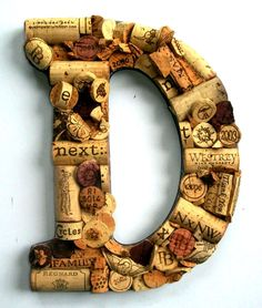 Idea for old wine corks...Use inital of last name to place in the foyer of our first house.