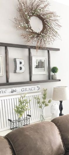 DIY home decorating ideas I LOVE - what a great use of an old ladder as a unique wall decor idea! Lots of gorgeous country decor living rooms on this page.