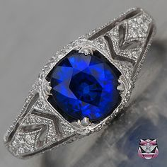 Sapphire Engagement Ring in Art Deco style is crafted in and stamped 18K white gold.