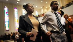 MIAMI GARDENS, FL - APRIL 15: Sybrina Fulton , the mother of Trayvon Martin who was killed by George Zimmerman, walks with her other son, Jahvaris Fulton, as they attend a service at the Antioch Missionary Baptist Church for the first time since the arrest of Zimmerman on April 15, 2012 in Miami Gardens, Florida. (Photo by Joe Raedle/Getty Images)