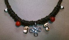 Tibetan bone skull beads with sterling friendship knot; leather neckpiece.