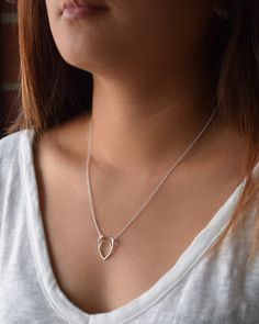 Your must-have fall necklace by Olive Yew. Dainty antler charm is available in silver or gold.