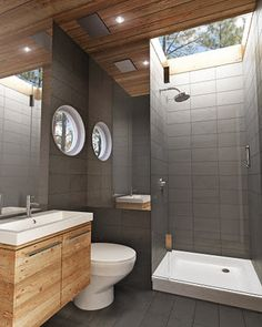 Compact bathroom design. Clever use of mirrors. Area behind shower and toilet for water heater?