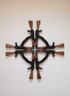 Mel Chin, Cross for the Unforgiven, 2012, Eight Romanian AK-47 WASR-10 Cal.7.62x39mm Assault Rifles
