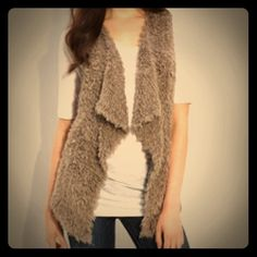 Kensie shaggy faux fur vest Never worn. Super soft and trendy. Kensie Sweaters