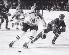 Esposito, Orr and Cashman taking on the Montreal Canadiens.