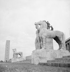 Ruins of the Olympic Stadium in Berlin. Gunner J Hamilton of Aberdeen and Lance Bombardier S Canfield of Leeds astride one of the great stone horses, 1945