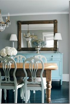 love this color palette.  and the rustic wood table with all the painted furniture- fab-bo!