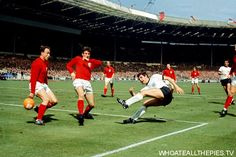 pa-photos_t_england-1966-world-cup-final-west-germany-colour-photos-1006l - West Germany's Lothar Emmerich (fourth l) fires a shot past England's George Cohen (l) and Martin Peters (second l) as England's Bobby Charlton (third l), Nobby Stiles (fifth l) and Roger Hunt (sixth l) look on