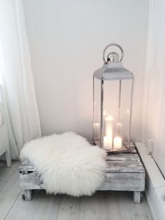 Scandinavian design with grey, fur, and metal. Light your lanterns with Candle Impressions White Pillars to get the same bright look.