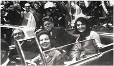 Jack and Jackie Kennedy riding in the motorcade in Dallas moments before President Kennedy was assasinated.