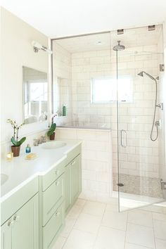master bathroom with steam shower fittings and in floor radiatn heat, limestone tiles, pebble stone sruface in shower, double vanity, arlington italianate toh tv house project Master Bathroom Shower, Laundry In Bathroom, Bathroom Renos, Small Bathroom, Bathroom Ideas, Shower Ideas, Tile Bathrooms, Bathroom Cabinetry, Bath Cabinets