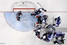 Slovakia's Marek Hovorka (R), Lukas Cingel (bottom 3rd R) and Tomas Marcinko (bottom 2nd R) fight with US players in the men's preliminary round ice hockey match between the US and Slovakia during the Pyeongchang 2018 Winter Olympic Games at the Gangneung Hockey Centre in Gangneung on February 16, 2018. / AFP PHOTO / Brendan SMIALOWSKI