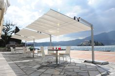Flexy cantilevered shade, from FIM - Italy. Flexy is a retractable shading system, and is available in a wide range of colours and sizes, and is suitable for use in residential and contract projects.