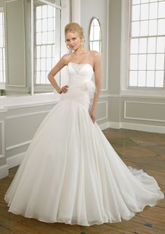 BRIDAL By Mori Lee Style 1656, love everything about this minus the little random flower but luckily that's removable =)