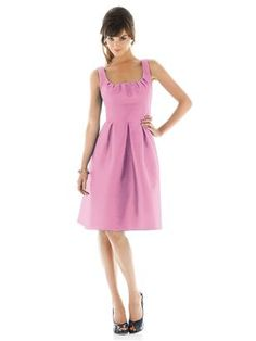 Cocktail length scoop neck dupioni dress with pleated detail at bodice. Wide matching waistband and pleated skirt with pockets at side seams. Sizes available 00-30W, and 00-30W extra length. Style D447