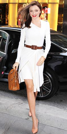 Miranda Kerr stepped out in Sydney in a belted white Willow dress, leather tote and nude pumps.