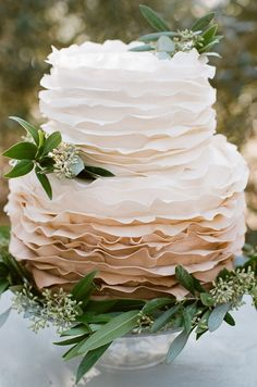 this ruffled cake!-- oh man, this would be awesome as a one tier cake! Not too crazy about the plants, but love the ruffles! :o