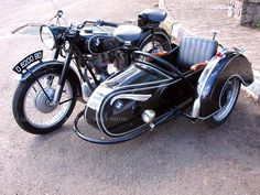 Motorcycle-vintage BMW with side car.