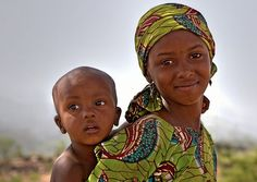 fulani tribe nigeria. The mama looks so young!