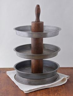 DIY idea: create a tiered stand using vintage baking tins and a rolling pin.