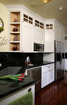 white cabinets, dark countertop
