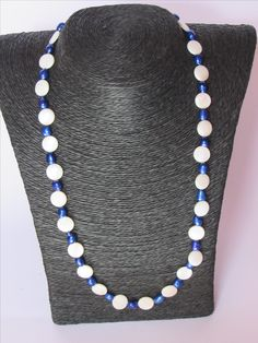 Shell beads with blue sweetwater pearls and a silverplated clasp