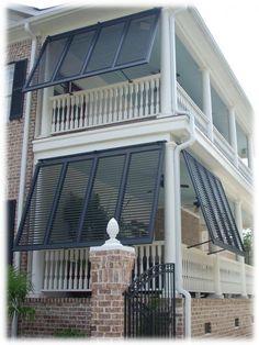 Bahama porch shutters on double veranda - love the haint blue porch ceilings
