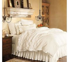 Love the shelf as a headboard and using chandeliers rather than table lamps