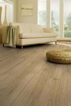 """Timberland Oak is from the Elegance Royale Collection and is a fantastic looking traditional oak floor. This hardwearing floor has wear layer, micro bevelled edge and a treated PUR + surface, giving a """"T"""" abrasion rating. Vinyl Flooring, Flooring Ideas, Luxury Vinyl Tile, Wood Vinyl, Plank, Timberland, Sweet Home, Lounge, Couch"""