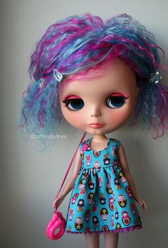 Great hair and what a lovely matryoshka dress!