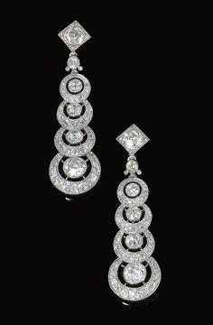 Pair of diamond pendent ear clips, Cartier, Circa 1910
