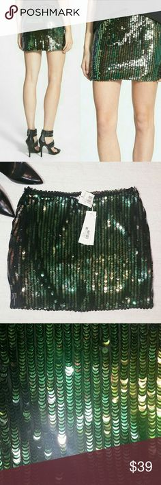 Glamorous green scale sequin skirt Side zip. Fully lined Green and black iridescent sequins Length 15.5 Waist 15 Hip 19  New with tags. Nordstrom. Glamorous Skirts Mini
