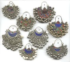 Kuchi (Afghanistan) traditional/tribal earrings/nose rings, with inlays, dangles and filigree.  Amazing variety and detail.  Available from Organicjewelry.com.