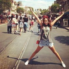 What People REALLY Wear To The Happiest Place On Earth #refinery29 http://www.refinery29.com/disney-world-outfits#slide1 Which is cuter: Ashley Madekwe's power pose or her color-coordinating mouse ears and crossbody?