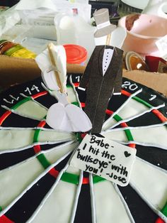Dart board cake with dart bride and groom