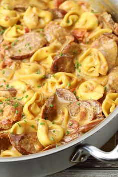 Andouille Sausage and Tortellini Skillet Meal is an easy one pan meal. Sausage and tortellini are coated in a cheesy tomato sauce and topped with chives. Chicken Andouille Sausage Recipe, Chicken Sausage Recipes, Sausage Dinner Recipes, Kilbasa Sausage Recipes, Sausage Meals, Cheese Tortellini Recipes, Sausage Tortellini, Tortellini Ideas, Pasta With Sausage