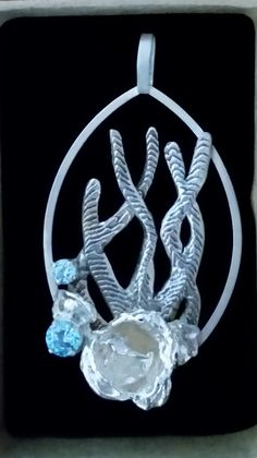 Handmade sterling silver, cuttlefish casting, water casting, blue cz, pendant.