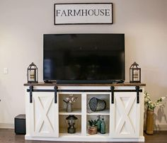 This barn door console is sure to make an impression in your home! This amazing and unique piece can be used as a TV console, kitchen hutch, buffet, or sofa cabinet. These sliding barn door consoles are handmade ranging in length from to Farmhouse Tv Stand, Farmhouse Chic, Country Farmhouse, Barn Door Console, Tv Stand Decor, Tv Stand Designs, Living Room Tv, Interior Barn Doors, Custom Furniture