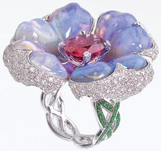 "Katherine Jetter ""Poison Berry"" ring with carved opal flower petals around a 4.30 carat rubellite with diamond micro-pavé and tsavorite pavé twisting around the finge"