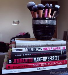 Makeup Books and the brushes in the pic are called ( real technique ) MY NEW JAM LOVE THEM. Ill shall say they are better than MAC and half the price