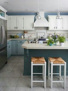 Three colors on cabinetry: white uppers, light grayish blue base and darker grayish blue island