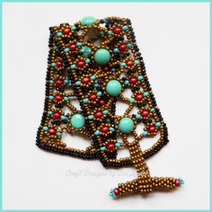 Multiple stitch 2 hole bead bracelet was inspired by Cleopatra. You can learn how to take working with 2 hole beads up to the next level with this bold bracelet fit for a queen.