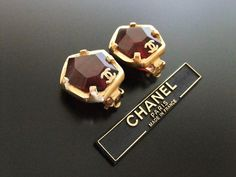 Authentic vintage Chanel earrings red plastic stone gold CC by Chanel | Vintage Five