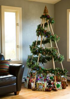 Instead of buying a whole tree, just buy a garland and wrap it round a tree-shaped bamboo structure. Very avant-garde. [Photo: Pinterest]